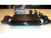 PS3 Slim 500GB + 2x Dualshock + 8 Games + all cables GREAT CONDTION
