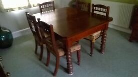 Extending mahogany dining table and set of 6 matching chairs