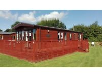 Corner pitched holiday lodge for sale at Yaxham Waters Holiday Park set in beautiful countryside