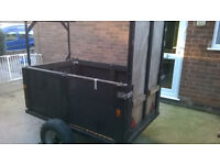 5ft x 3ft trailer can be flat bed , almost new heavy duty suspension , drop ramp & light board
