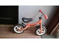 red avigo balance bike