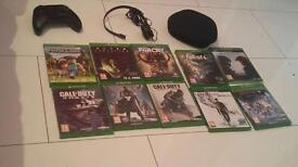 Xbox One plus 10 games ,1 normal controller and one Elite Controller
