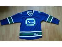 Brand new Reebok Vancouver Canucks Ice Hockey Jersey. Size M.