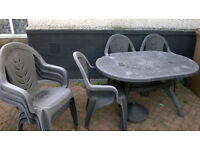 black garden table and six chairs