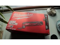 The Milwaukee C12MTM12 Cordless Multi-Tool with charger and battery