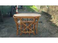 Wicker table and 2 chairs ideal space saver
