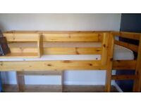 raised wooden single bed with mattress