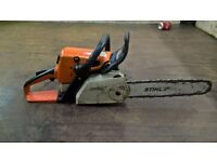 Stihl MS210C chainsaw with a 14inch bar.