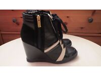 Jessica Simpson High Wedge Trainer Boots. Size 5/38. Used once. Like New.