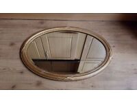 Possibly vintage oval shaped mirror with gold frame
