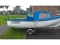 15ft oyster boat and 15hp mariner outboard