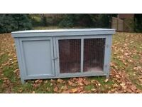A used but in good condition hutch for a rabbit or guinea pig.