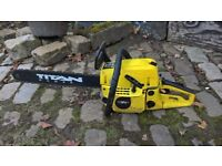 chainsaw and electric chain sharpener