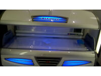 AS NEW 2 LUXURA GT SUNBEDS ONE WHITE ONE YELLOW