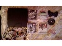 PS3 slim and one wireless controller 160g hard drive 5games