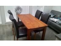 USED CONDITION DARK SOLID WOOD TABLE 4 FAUX LEATHER BLACK CHAIRS