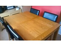 Pine extendable table and 4 matching black leather effect chairs, 2 chocalate leather effect chairs