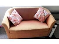 Orange two seater couch