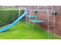 Metal climbing frame with slide.