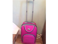 Small bright pink Ormi suitcase carry on travel bag