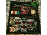 Blackjack, Craps, Roulette. Two packs of quality chips & small blackjack game.