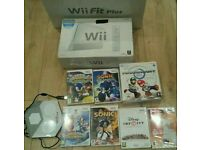 Nintendo Wii complete console with wii fit board 7 games nintendo wii wheel