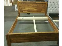 A brand new stylish rustic oak king size bed frame.