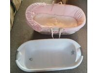 Pink Moses basket and baby bath