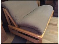 Two seater Futon Company Linear sofa bed with new cover great condition