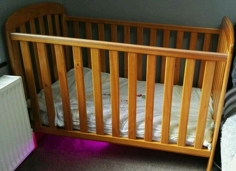Cot Bed complete with high quality mattress and mamas and Papas bedding set.