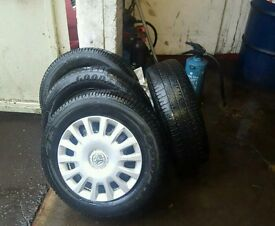 Genuine vauxhall corsa 14inch wheel trims and tyres