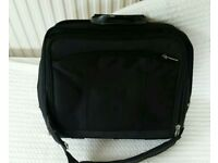 Black multi compartment laptop bag briefcase with handle and strap