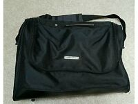 Black carry bag and professional tunic