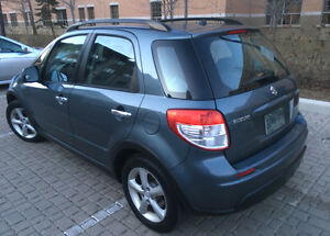 2009 Suzuki SX4 LIKE NEW 124000kms / sell-swap