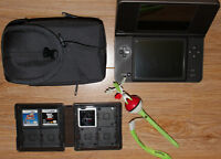 Nintendo DSi XL with games and accessories