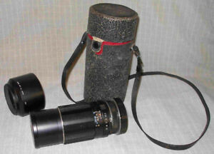SMC Takumar 1:4 200mm with hood and leather case. Both caps.