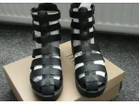 Truffle black gladiator shoes size 6