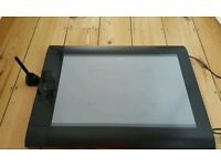 For sale is a Wacum Intuos 4 XL graphic tablet.