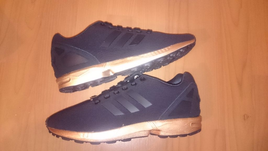 0de0082b2813e adidas all black zx flux