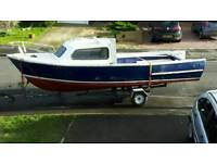 20ft fishing cabin boat and road trailer.
