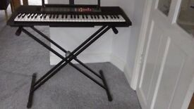 Yamaha PSR F50 portable digital keyboard with Tiger double keyboard stand & manual & AC adaptor.
