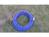Coil of pressure washer hose