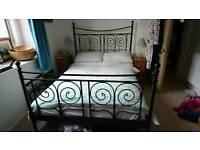 Black metal ikea bed frame and mattress