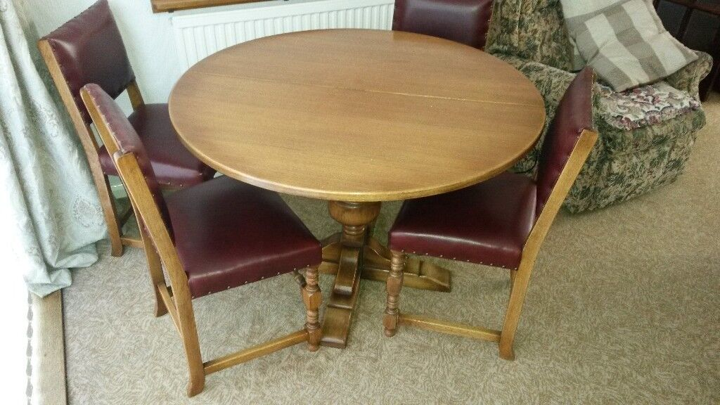 Medium oak round -extends to oval-dining table and 4 chairs REDUCED FOR QUICK SALE