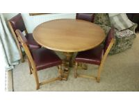Medium oak round -extends to oval-dining table and 4 chairs