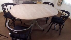 Dining Table and chairs - 4 Chairs and an extending table