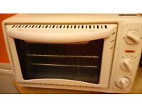 Small electric stand alone oven and grill