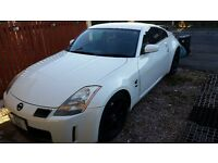 Nissan 350Z triptonic auto japenese import, pearl white, private plate, spoiler live the dream.