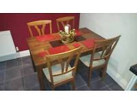 walnut wood dining room table and 4 chairs