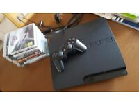 Playstation 3 like new with 8 games and controller